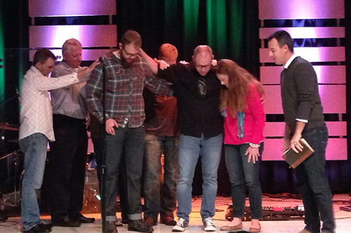 "Apostolic ""laying on of hands and prayer"" — commissioned and sent into the world to ""make disciples."""